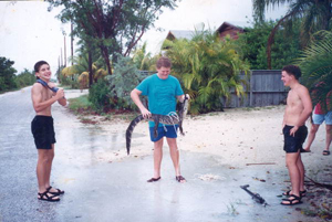 Schlesna brothers and friend with alligator they caught: Ramrod Key, Florida (1992)