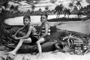 Stanley and Milton Weinkle sitting on a stuffed alligator: Miami Beach, Florida (1931)