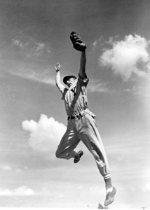 Outfielder Elson Konzen grabs a high one at Baseball School: Tampa, Florida (1948)