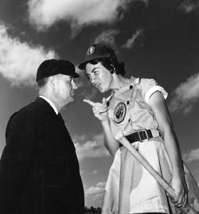 Fort Wayne Daisies player, Marie Wegman, of the All American Girls Professional Baseball League arguing with umpire Norris Ward: Opa-locka, Florida (1948)