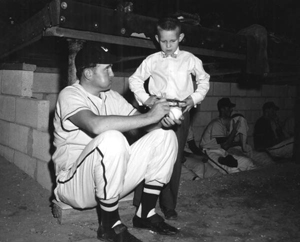 Minor league batting champ Neal Cobb signing baseball for fan: Crestview, Florida (1955)