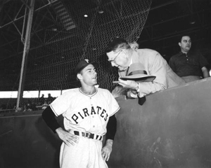 Pirate player at the Pittsburgh-Baltimore exhibition game chatting with general manager Branch Rickey (1955)