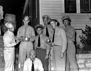 Ted Williams signing a baseball for Navy personnel: Panama City, Florida (ca. 1943)