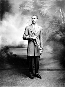 Portrait of blues clarinet player Raymond Sheppard holding a trumpet: Pensacola, Florida (between 1930 and 1949)