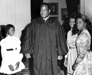 Supreme Court Justice Joseph W. Hatchett poses with his family: Tallahassee, Florida (1975)