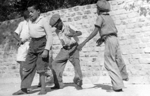 Four boys dancing in front of the Hemingway residence in Key West (1939)