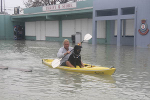 Man and his dog during Hurricane Wilma in Key West (2005)