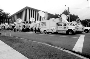 News service trucks in town during the 2000 presidential election vote dispute (2000)