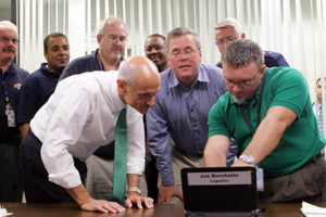FEMA contractor demonstrating new system to Governor Jeb Bush and Michael Chertoff, Secretary, U.S. Department of Homeland Security (2006)