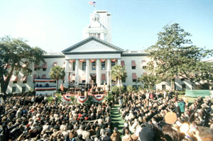 Crowd during inauguration ceremony on the east lawn of the Old Capitol (1999)