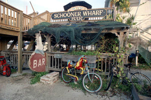 """Schooner Wharf Bar"" at the Key West Bight: Key West, Florida (199-)"