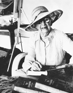 Marjorie Stoneman Douglas with her book, Everglades; River of Grass (1965)