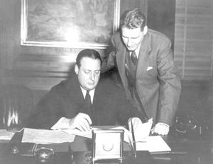 U.S. Secretary of the Interior J.A. Krug signing the papers to create the Everglades National Park (1947)