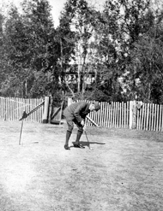 Dr. Tennent Ronalds putting on golf course: Leon County, Florida (ca. 1907)