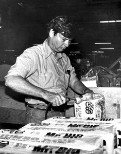 Governor Bob Graham sealing packages of paper napkins (1979)