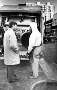 Florida Governor Bob Graham talking with a City of Tallahassee garbage collector: Tallahassee, Florida (1979)