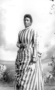 Woman in striped dress holding handkerchief