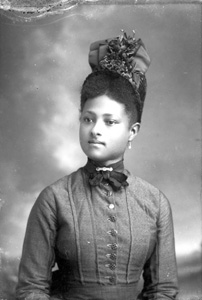 Young woman wearing fancy hat