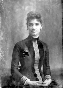 Woman in dress with embroidered front and cuffs