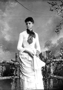 Young African American woman wearing a white dress