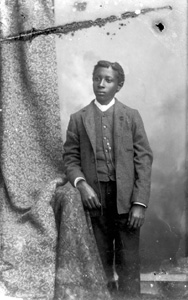 Young man in plaid coat and vest