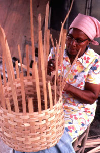 Lucreaty Clark making a white oak basket (not after 1979)