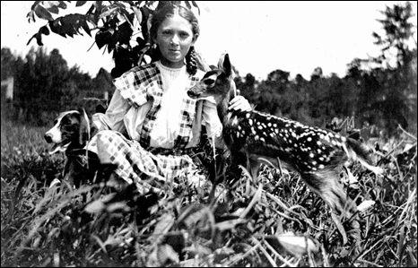 Eloise Morris with dog and fawn (ca. 1913)