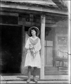 Dollie Booth on the porch of Booth's store (192-)