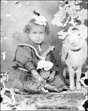 Portrait of Hazel Harrell with a cat and goat