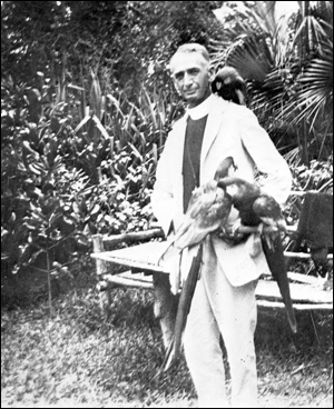 Pastor with pet macaws (1939)