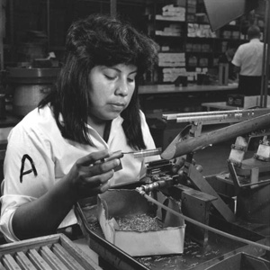 Seminole woman assembling connectors at a factory (1967)