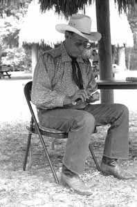 Frank Billie carving at the 1995 Florida Folk Festival: White Springs, (1995)