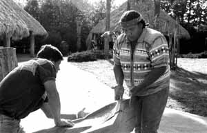 Danny Wilcox (right) and Bobby Henry (left) with dugout canoe: Tampa, Florida (1988)