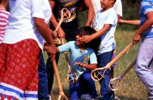 Seminole children playing stick ball: Big Cypress Seminole Indian Reservation (1989)