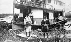 Seminole canoe encounters steam ship (late 1800s)