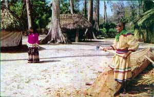 Man making a dugout canoe at the Seminole Village in Silver Springs (1950s)