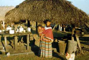 Woman with child at the Dania Seminole Indian Reservation (1958)