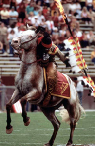 "Florida State University's mascot, ""Chief Osceola"" riding Renegade before a game at Doak Campbell Stadium: Tallahassee, Florida (1970s)"