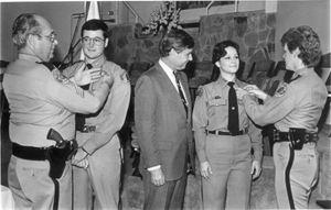 New recruits at Florida Highway Patrol are pinned by their parents: Tallahassee, Florida (1984)