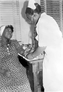 Expectant mother having her blood pressure taken by a registered nurse in Leon County, Florida