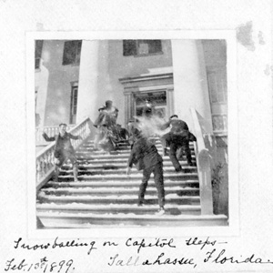 Men snowballing on capitol steps: Tallahassee, Florida (1899)
