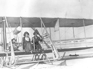 "Aviatrix Ruth Law and Mrs. Robert Goelet in model ""B"" Wright airplane: Daytona Beach, Florida (1914)"