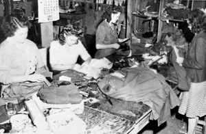 Women at Camp Gordon Johnston sewing on insignia (between 1942 and 1944)