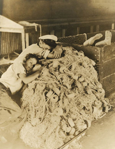 27. Boys sleep in the fish house on the idle nets