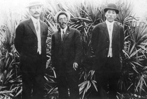 Three Japanese American men posing for a picture (ca. 1913)
