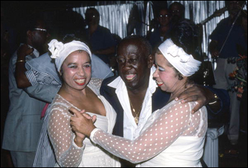 The Scull sisters, Haydee and Sahara, dance with Facundo Rivera at Club Basque: Little Havana, Miami, Florida (1985)