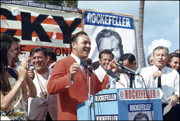 Florida Governor Claude Kirk speaking at campaign beach party for Republican presidential candidate Nelson Rockefeller: Miami Beach, Florida (August 1968)