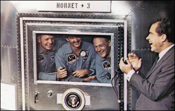 "Apollo 11 Astronauts (left to right) Neil Armstrong, Michael Collins and Edwin ""Buzz"" Aldrin greeted by President Richard Nixon upon their return from space: Aboard the U.S. S. Hornet in the Pacific Ocean (July 24, 1969)"