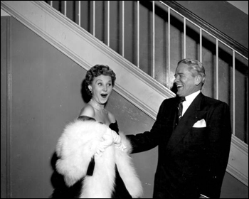 "Mari Aldon makes Governor Warren laugh at the celebration for ""Distant Drums"" premiere: Saint Augustine, Florida (1951)"