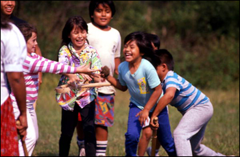 Seminole children playing stick-ball: Big Cypress Reservation, Florida (1989)